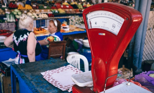 Food scale and women talking